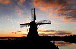 Windmill silhouette at sunset Royalty Free Stock Image
