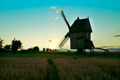 Windmill silhouette at sunset Stock Image