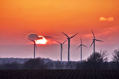 Windmill silhouettes Stock Images
