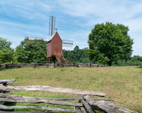 Windmill. A single windmill on a country farm stock images