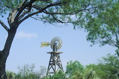 1904 windmill on site of Judge Roy Bean in Langtry, TX stock images
