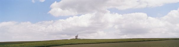 Windmill skyline. Panoramic view Windmill on skyline close to Mont San Michel France. Copyspace stock photography