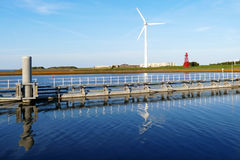 Windmill, sluice and lighthouse on Oostkade van Den Oever, Wieri Royalty Free Stock Images