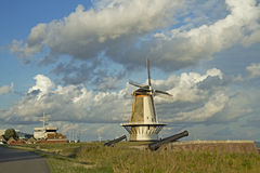 Windmill in small Dutch town Vlissingen (Zeeland, Netherlands). Royalty Free Stock Image