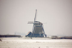 Windmill in the snow. A windmill in a snow landscape Royalty Free Stock Images