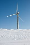 Windmill in snowy Dutch landscape Royalty Free Stock Photography