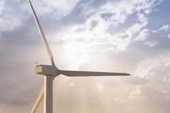 Windmill and solar cell against smooth cloudy sky Stock Photography