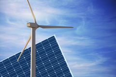 Wind mill and solar cell against smooth cloudy sky Stock Photos