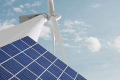 Windmill and solar cell against smooth cloudy sky Royalty Free Stock Photos