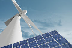 Wind mill and solar cell against smooth cloudy sky stock images