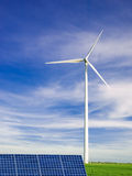 Windmill and solar panel. Symbols of environment conservation and clean energy Royalty Free Stock Photography