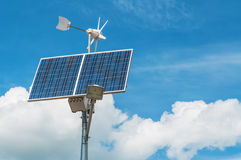Windmill and solar panel Stock Photos