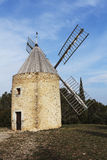 Windmill in the south of france Stock Photo