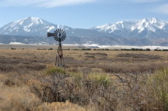 Windmill and Spainish Peaks. Old windmill at the foot of the Spainish Peaks Colorado stock photos