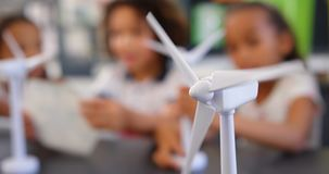 Windmill spinning on a desk in the classroom 4k stock video