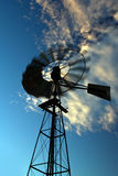 Windmill spinning fast at sunset Stock Photography