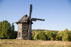 Windmill standing on the edge of the autumn forest Royalty Free Stock Photos