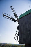 Windmill standing in the field against the blue sky Royalty Free Stock Photo