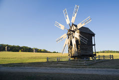 Windmill standing in the field against the blue sky Royalty Free Stock Photography