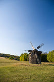 Windmill standing in the field against the blue sky Stock Photos