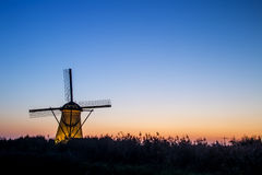 Windmill Standing silhouette at sunset Royalty Free Stock Image