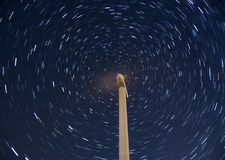 Windmill with Star Trail. At night royalty free stock photography