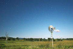 Windmill with stars Royalty Free Stock Images