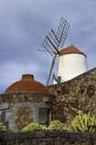 Windmill and stone wall Royalty Free Stock Images