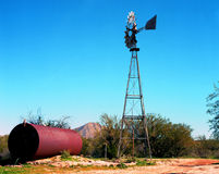 Windmill and Storage Tank Royalty Free Stock Photography