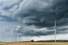Windmill with Stormy Sky. Cloudy Sky over the Wheat Field Stock Photo