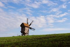 Windmill with a straw roof Stock Photo