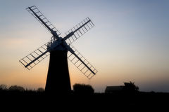 Windmill in stunning landscape on beautiful Summer dawn Stock Photography
