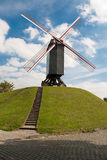 Windmill at suburbs of Bruges Royalty Free Stock Images