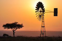 Windmill. With sun background in Africa Royalty Free Stock Photography