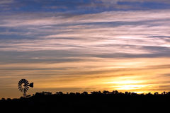 Windmill at Sunrise. Sunrise with a windmill in Arizona Stock Photos