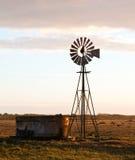 Windmill at sunrise Stock Image