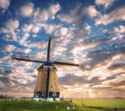 Windmill at sunrise in Netherlands. Beautiful old dutch windmill Stock Photo