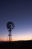 Windmill at sunset. Silhouette of a windmill at sunset Royalty Free Stock Images