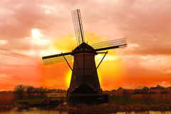 Windmill at sunset. Stock Photos