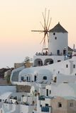 Windmill at sunset. Oia Santorini Greece Stock Images