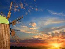 Windmill on sunset background Stock Photography