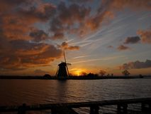 Windmill with sunset Stock Image