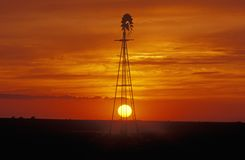 Windmill at sunset in Forgan, OK Royalty Free Stock Photo