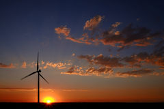 Windmill at Sunset Generating Sustainable Power Royalty Free Stock Photography