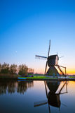 Windmill at sunset in the Netherlands Royalty Free Stock Images