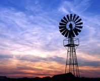 Windmill at sunset Stock Photos