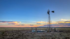 Windmill at Sunset on the Plains Royalty Free Stock Photography