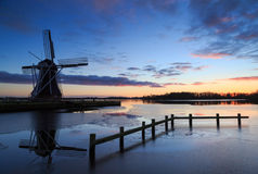Windmill sunset Stock Image