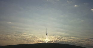 Windmill and sunset view. Windmill, renewable energy and sunset view Royalty Free Stock Images