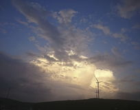 Windmill and sunset view. Windmill, renewable energy and sunset view Royalty Free Stock Photos